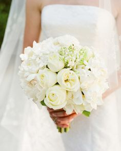 Gardenias, stephanotis, lily of the valley, polo roses, and peonies are arranged in small groupings for a bouquet that mixes elegance and a contemporary vibe.
