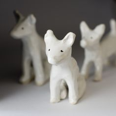 Ceramic Dog, small and white, sitting.