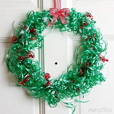 "A simply wonderful DIY ribbon wreath brings ""tie""-dings of great joy! Click for how-to tips and more DIY Christmas wreath ideas."