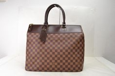 Louis Vuitton Hand Greenwich Pm Browns Damier Leather Tote Bag. Get one of the hottest styles of the season! The Louis Vuitton Hand Greenwich Pm Browns Damier Leather Tote Bag is a top 10 member favorite on Tradesy. Save on yours before they're sold out!