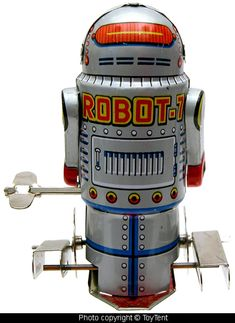 "Mechanical walking Robot 7 Tin toy robot with built-in key is 4"" tall"