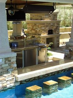 The outdoor kitchen. The breakfast bar. Bar chairs, breakfast in the pool…