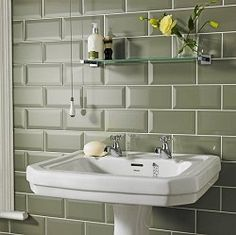 Olive green bathroom wale tiles compliments the yellow flower and white sink. http://glstonetile.com/stones.php?cu=GL7504
