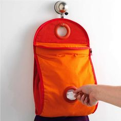 Plastic Bag Dispenser - we could make this at home! Plastic Bag Dispenser, Laundry Basket, Storage Organization, Bags, Orange Red, Kitchen Ideas, Gadgets, Shops, Space