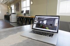 Hot desk working area, open plan office interior at Delete Leeds   by Redesign