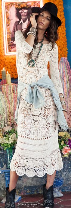 Crochet boho chic maxi dress with modern hippie chunky bracelets and American…