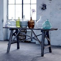 Table of old wood and recycled vases by Bloomingville. www.bloomingville.com