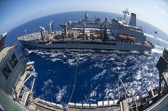 The aircraft carrier USS Dwight D. Eisenhower (CVN 69) and German frigate FGS Hamburg (F220) conduct a replenishment-at-sea in the Mediterranean Sea. Description from pinterest.com. I searched for this on bing.com/images
