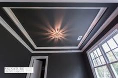 Stunning home office features black walls and tray ceiling trimmed with white crown molding lit by a small Anemone Flushmount Pendant. Black Crown Moldings, Ceiling Crown Molding, Shiplap Ceiling, Ceiling Trim, Gypsum Ceiling, Black Ceiling, Moldings And Trim, Moulding, Grey Walls White Trim