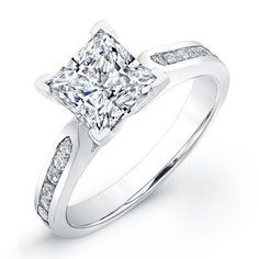 This cathedral princess cut diamond engagement ring features twelve round brilliant diamonds channel set t in gold or platinum design. Twelve round brilliant cut diamonds weighing about 1/3 carat weight. This gorgeous ring is a must have for anyone looking for a classic princess cut diamond ring.