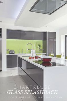 Chartreuse Green Glass Splashback in a modern Gloss Kitchen. Green is the perfect colour to offset a grey kitchen, fresh, modern and clean it can make even the darkest of kitchens sing.