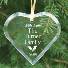 """Engraved Glass Heart Family Keepsake Christmas Tree Ornaments. Share the Christmas spirit and the joy of giving this Christmas by giving our Personalized Merry Christmas Glass Heart Ornament. This personalized glass Christmas ornament makes a great gift for family & friends. Each Engraved Christmas Heart Glass Ornament measures, 4"""" x 3"""". Our Personalized Christmas Heart Ornament includes a golden ribbon loop and Free Gift Pouch."""