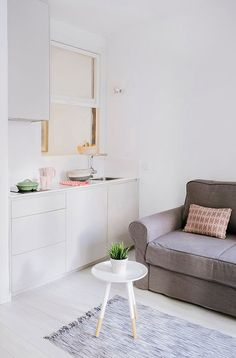 white madrid apartment with modern decor and pops of pale pink and green / sfgirlbybay