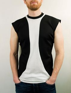 This modern sleeveless shirt is handmade in my studio from white organic cotton jersey and double-layered black organic cotton jersey.  Great casual shirt for a stroll around the city, paired up with jeans, or for the night out clubbing. Looks great on its own or with a blazer on top. In order to accurately measure yourself please take a quick look at these two short YouTube videos: http://youtu.be/hIDwEF9XwGQ http://youtu.be/0WHtucbayPI  Small Shoulders: 42cm &#...