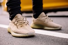 http://SneakersCartel.com On Feet Preview of the adidas Yeezy Boost 350 V2 'Dark Green' #sneakers #shoes #kicks #jordan #lebron #nba #nike #adidas #reebok #airjordan #sneakerhead #fashion #sneakerscartel