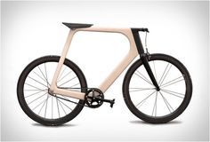 This bicycle named Arvak is a creation of French design studio Keim. With the collaboration of the workshop Breitfuss Arvak is a bike that has a hollow monocoque frame made of 24 layers of laminated ash wood and a bio-sourced resin. Wood Bike, Wooden Bicycle, Futuristic Motorcycle, Motorized Bicycle, Bike Style, Bicycle Design, Cycling Bikes, Automotive Design, Electric Cars