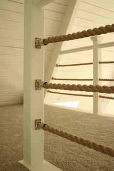 "Nautical rope railing. Stainless steel boat bimini rail mounts with 1 1/4"" promanila rope."