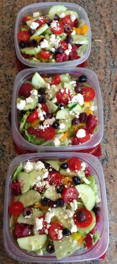 Meal prep for the week. Greek salads: lettuce, cherry tomatoes, cucumbers, pepperoncini, kalamata olives, sweet peppers, red onions, feta cheese.