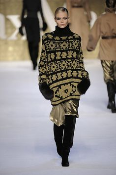 In keeping with the oversized big sloppy sweaters this fall Max Mara have come up with a lovely color work sweater Fair Isle-esque sweater with a turtleneck.