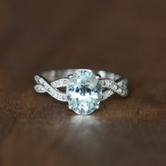 Infinity Diamond and Aquamarine Engagement Ring in 10k by LuxCrown