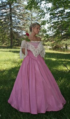 """How romantic is this beautiful Civil war inspired ball gown? You will get many second glances wearing this ball gown made up in your choice of shimmering moiré bengaline. The closely-fitted bodice features a face-framing off the shoulder neckline, trimmed out with yards of deep ruffled lace. Bands of lace accent the front of the bodice while the wide ruffle that surrounds the neckline dips to a deep """"V"""" in front. The bodice front and back echo the """"V"""" where it joins the very full skirt."""