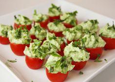 tomato pesto bites -  easy. tomatos filled with cream cheese, basil pesto, avocado and lemon juice