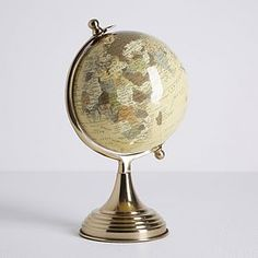 Designed with a vintage look, this classic globe features a rustic gold base with a detailed world map on a cream background. Self Adhesive Backsplash Tiles, Tile Care, Painted Globe, Hand Painted, Detailed World Map, Gold Globe, Mirror Tray, Wall Accessories, Gold Ornaments