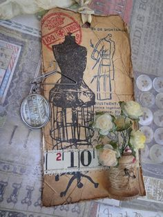 Tim Holtz Tags, Mannequin Die, Ruler Ribbon and Mini Hangers are just some of the things that make this a piece of art.