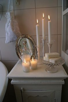 ♥ Love the peaceful candle light, white soaps prettily displayed and lovely mirror, well, everything... in this country bathroom...