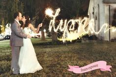 Bride and groom kiss with name written by sparkler, photographed by Frozen Exposure | The Pink Bride www.thepinkbride.com