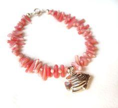 Pink Coral Bracelet, Silver Fish Bracelet, Angel Fish Charm Bracelet, Beach Jewelry UK by JewelleryByJora on Etsy https://www.etsy.com/listing/152412310/pink-coral-bracelet-silver-fish-bracelet