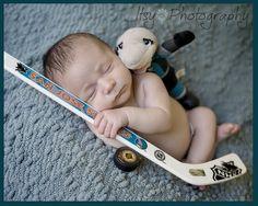 We've got a mini San Jose Sharks fan!!  Train em' young!