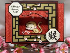 handmade card ... Chinese New Year: Year of the Monkey ... shadow box card ... cutting machine and cutting files use ... like the shimmery gold paper with the black grid lines ...