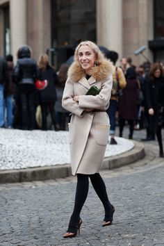 Would kill for the coat she's wearing :)..absolutely fabulous