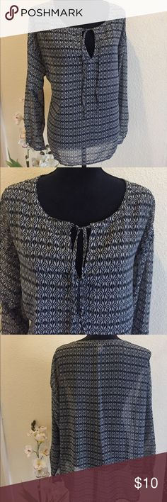 Sheer Black and White Printed Top Loose fit sheer top. Tie front can be worn tied, in a bow, or open. Layer with a camisole or a fitted long sleeve shirt under for the cooler days. One button on each sleeve.  Reasonable Offers Accepted. Old Navy Tops Blouses