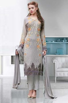 Grey Georgette, semi stictch trouser suit. Allover embroidered with embroidered, resham, zari and stone work.  V neck, Below knee length, full sleeves kameez.   Grey santoon trouser.   Grey chiffon dupatta with lace border with work.  http://www.andaazfashion.us/salwar-kameez/trouser-suits/occasion/party-wear-trouser-suit