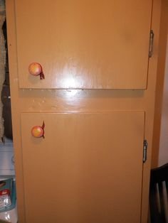 Our laundry room cabinets painted gold