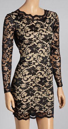 Black & Cream Scalloped Long-Sleeve Dress http://aguidetowhatsinsideyourbeautybag.blogspot.com/2013/12/meaningful-beauty-creme-de-serum.html