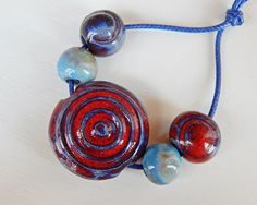 Set bead-lentil blue and red . By Mª Carmen Rodriguez Martinez ( Majoyoal ) https://www.facebook.com/groups/CeramicArtBeadMarket/