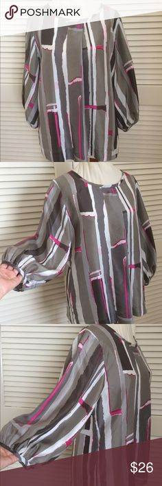 DKNY 100% Silk Gorgeous Blouse 😍DKNY 100% Silk Gorgeous Blouse. Size 8. Blouson sleeves, longer almost Tunic length with pocket at side. Fabulous unique Chic pattern!! Pair this with leggings, jeans and some great looking boots!! 👍👍 Dkny Tops Blouses