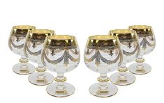 """This Italian Made Glassware is made of high quality crystal with use of the """"true engraving"""" technology. Hand-modeled glasses are solely hand-decorated with brushes to create a truly unique design, making them highly noticeable in front of mass produced machine-made competition. Engraved with bright gold and quality-controlled at every phase, this set will be an absolutely beautiful addition to your premium drink-ware collection. Comes in gift packaging and makes an impressive gift that will… Mason Jar Wine Glass, Gift Packaging, Vintage Designs, Brushes, Competition, Plating, Italy, Bright, Technology"""