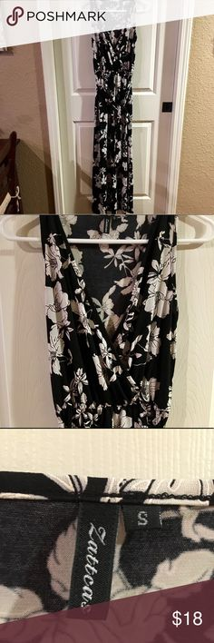 """Floral Maxi Dress New! Size small with a lot of stretch! V neck, sleeveless, empire waist, floral maxi dress that ties at waist. I bought this for a conference and didn't end up wearing it. It measures 56"""" from shoulder to hem. I am 5'5"""" and it hits the top of my foot.  Material: polyester/spandex blend. Soft and stretchy! Dresses Maxi"""