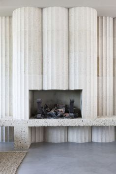 Love these fluted Terrazzo columns - great texture and shape - Retrovius FIREPLACE