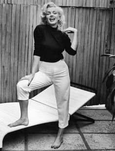 When Marilyn Monroe wasn't illuminating the screen or painting the town red, she was cozied up in classic American staples.