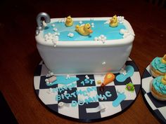 Used bread pan, turned upside down. White frosting and just did little frosting bubbles. I used one big duck and tin foil for the faucet. Much easier than I thought it was going to be. Turned out cute!