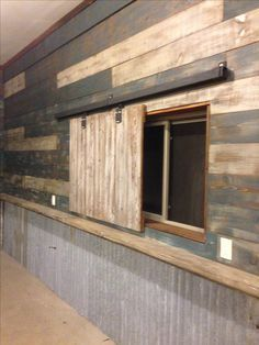 I like interesting use of wood My garage (Man cave). Used reclaimed barn wood and door hardware to create slider to cover the windows. The walls are made from new lumber and distressed (found the idea on here, thanks). The shelf and tin is also reclaimed. Basement Windows, Garage Walls, Garage Doors, Front Doors, House Doors, Sliding Doors, Garage Signs, Entrance Doors, Patio Doors