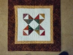 This was made from left over half  square triangle from wedding quilt for my sister  Mary when she married Less McGrath.  Machine pieced and hand quilted by Barbara E Dube Brennan