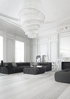 white on white living space makes the grey seating pop. Original details on the ceiling and walls add elegance and character