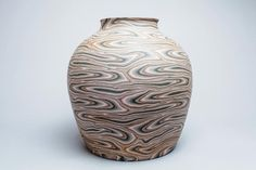 Matusi Kōsei Japanese, 1927-2003 Vessel, 1984-1985 Neriage clay in brown, grey, white and pale pink; h. 11 ¼ in. (28.6 cm); w. 11 ¼ in. (28.6 cm) Carol and Jeffrey Horvitz Collection