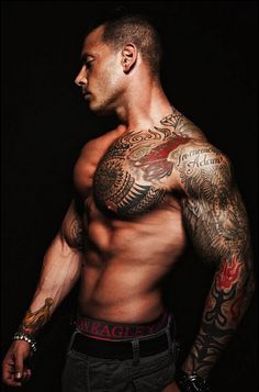 I love the full-sleeve + one pec tattoos, especially if the guy is dedicated enough to build the muscles to match.  These really balance well on a body and have a stunning effect, especially if the guy man-scapes.